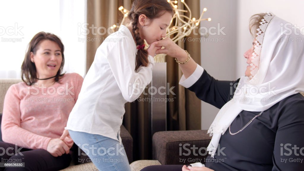 Hand kissing ceremony in Bayram stock photo