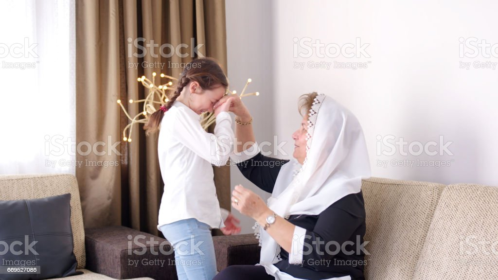 Hand kissing ceremony in Bayram stock photo