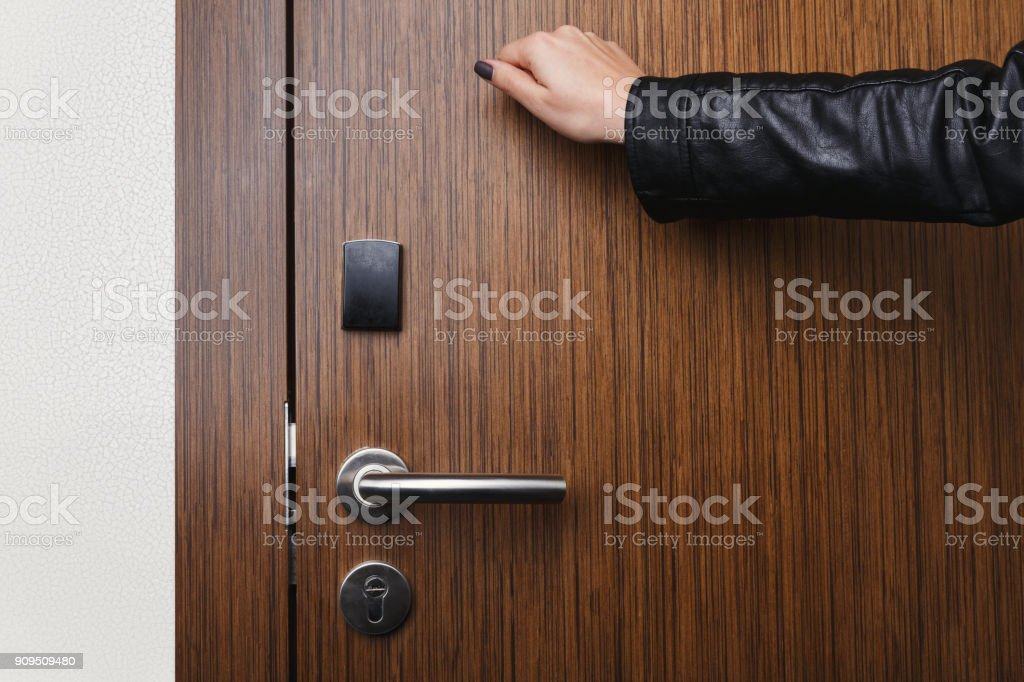 Hand knocking on hotel door with electronic lock stock photo & Royalty Free Woman Knocking On Door Pictures Images and Stock ...