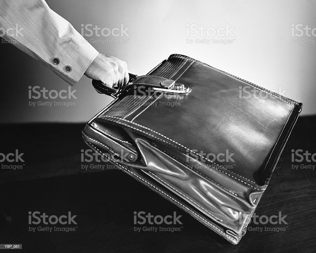 Hand lifting briefcase royalty-free stock photo