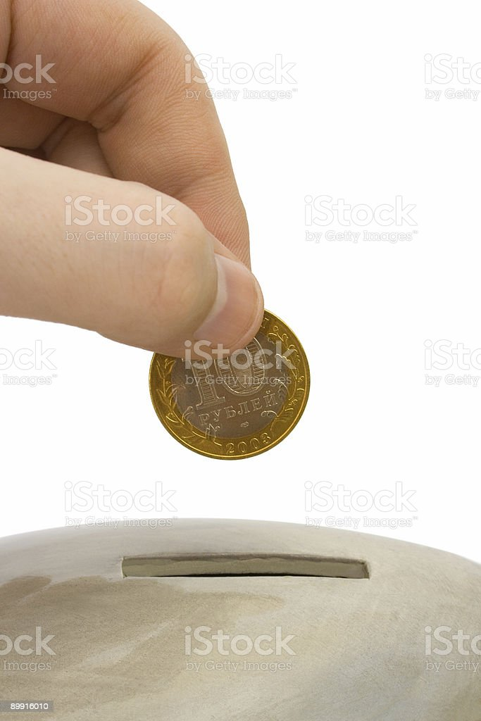 Hand load coin to bank royalty-free stock photo