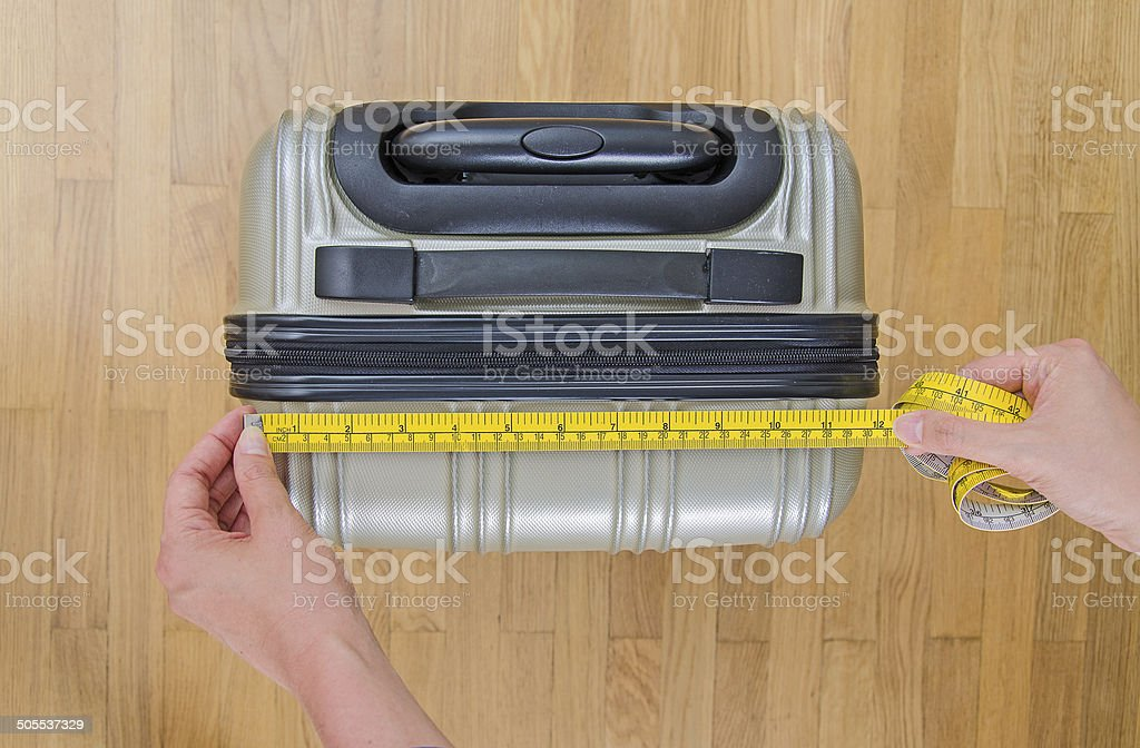 Hand luggage measurement using measuring tape. stock photo