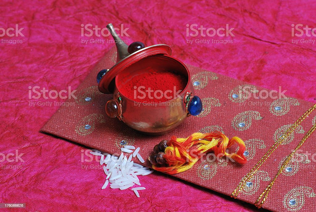 hand made cover with rakhi, kumkum and rice used festival stock photo