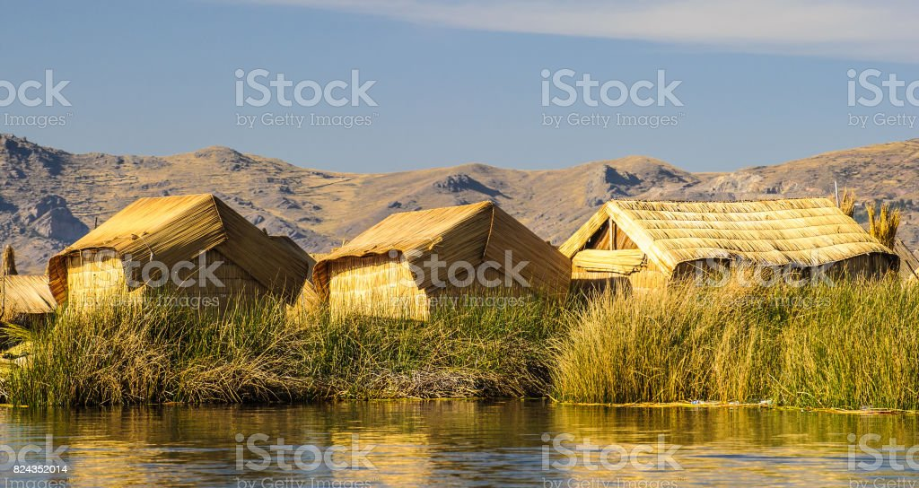 Hand made houses in Uros, artificial islands made of floating reeds, Peru, South America. stock photo