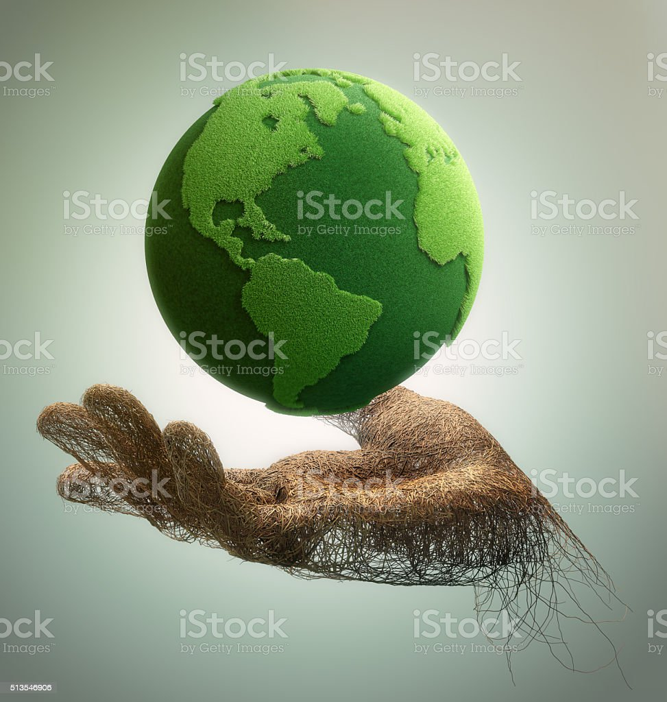 hand made of branches holding a green earth stock photo