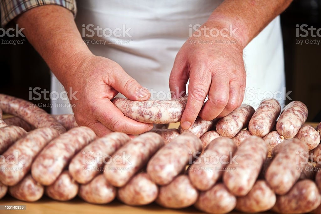 Hand made sausages at the butcher shop stock photo