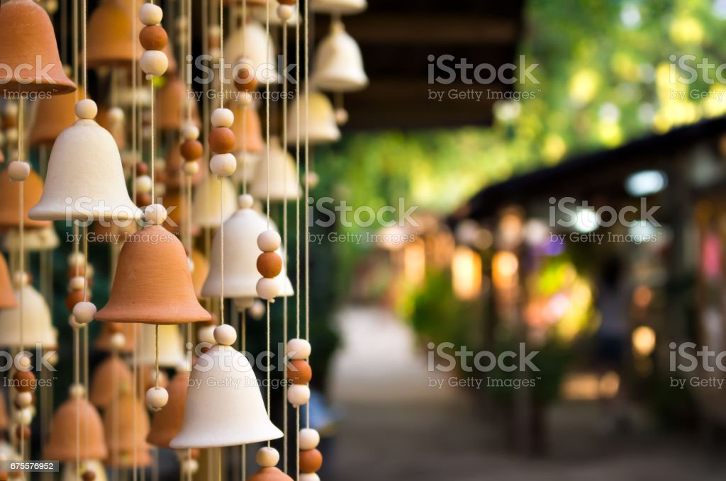 Hand made wind chimes hanging on a string stock photo