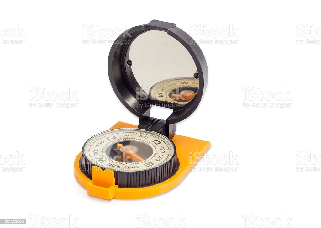 Hand magnetic compass on a light background foto stock royalty-free