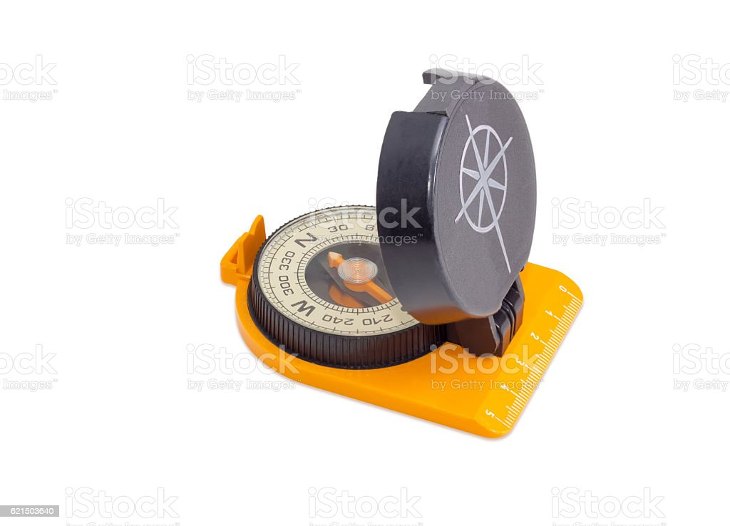 Hand magnetic compass on a light background photo libre de droits