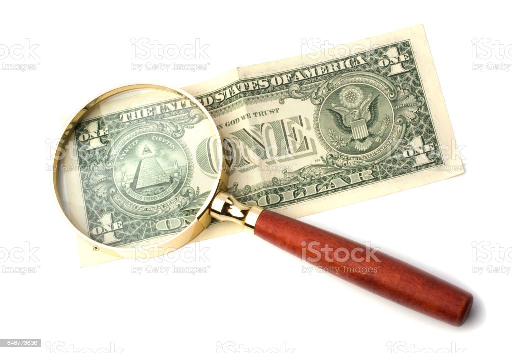 hand magnifier over banknote isolated on white background stock photo