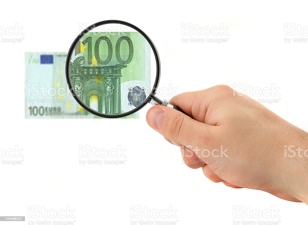 hand magnifying 100 Euro note royalty-free stock photo
