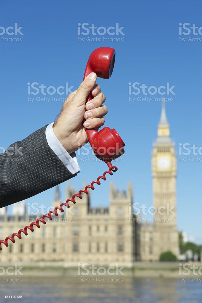Hand Makes Emergency Telephone Call Houses of Parliament royalty-free stock photo