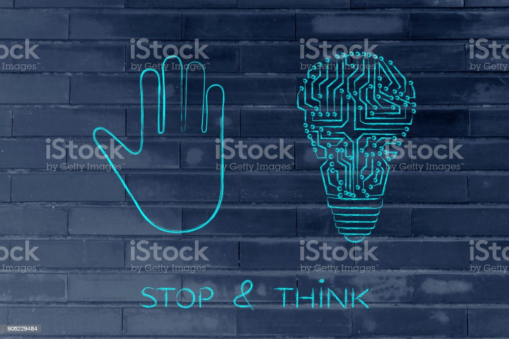 hand making a stop gesture and electronic lightbulb (idea) stock photo
