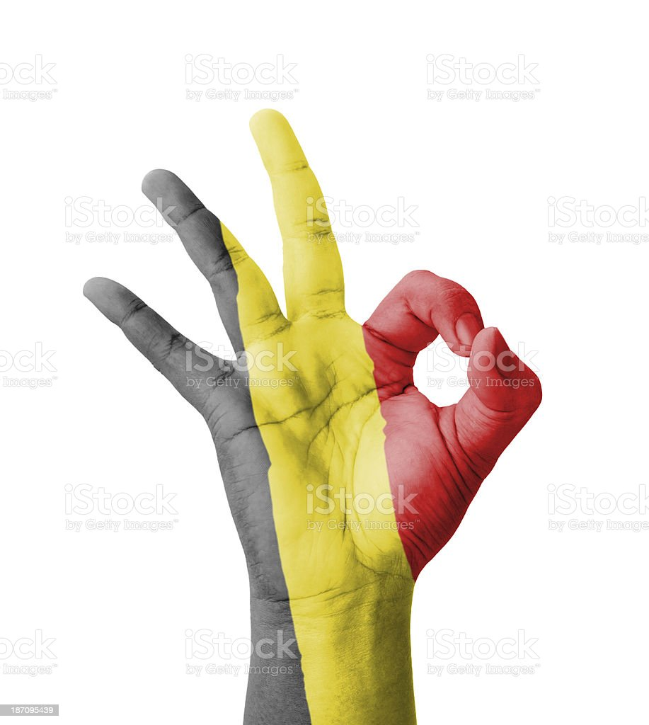 Hand making Ok sign, Belgium flag painted stock photo