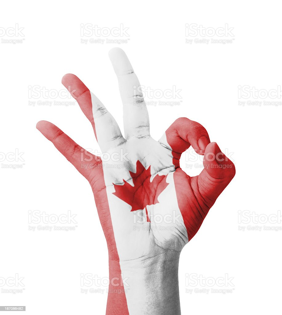 Hand making Ok sign, Canada flag painted stock photo