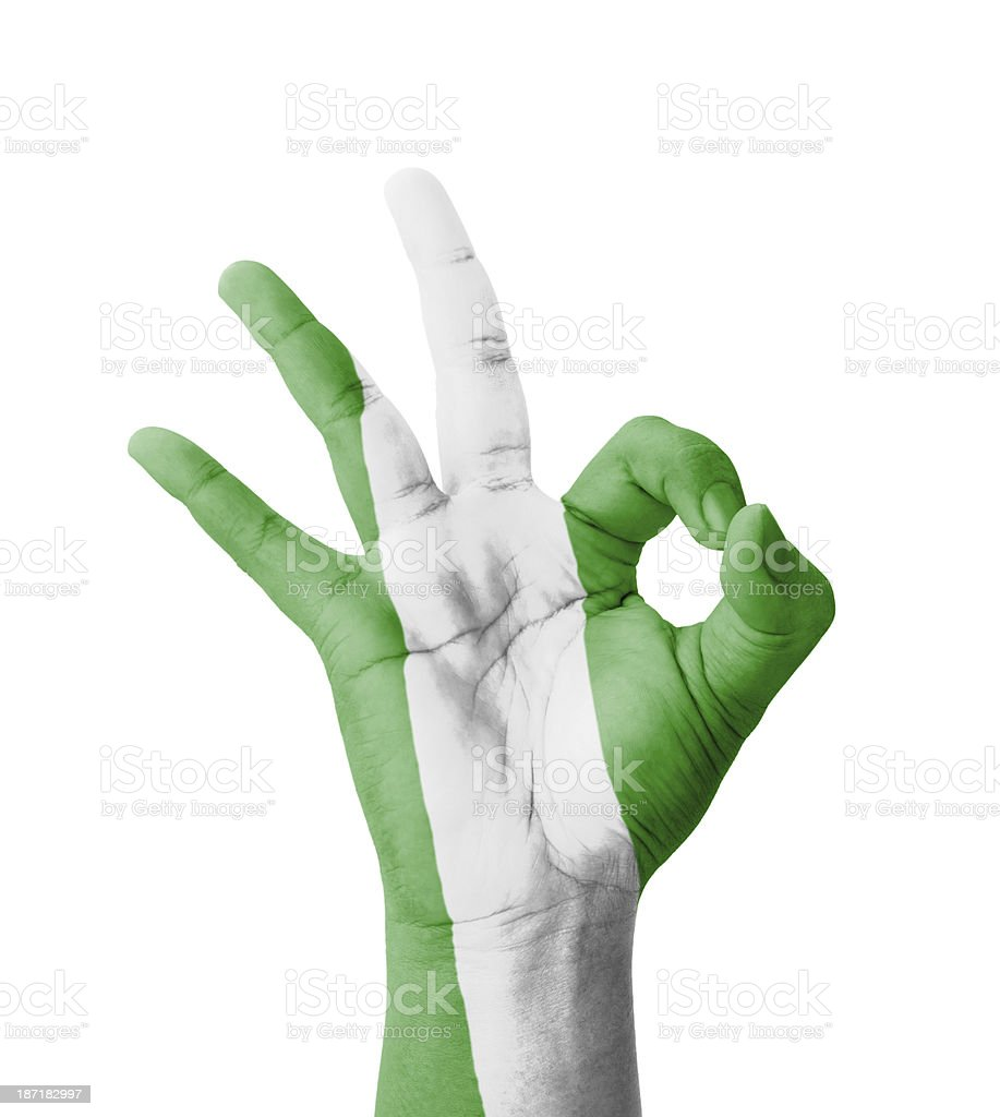 Hand making Ok sign, Nigeria flag painted stock photo