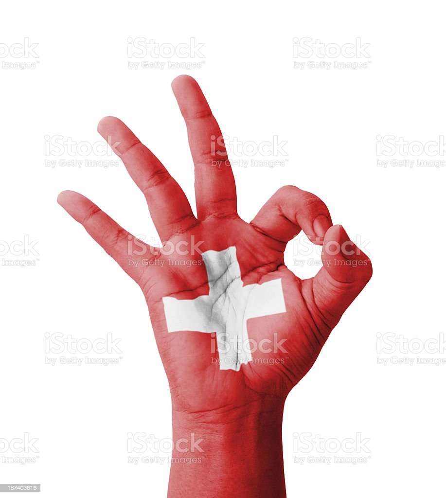 Hand machen Ok-Zeichen, Schweiz Flagge gemalt – Foto