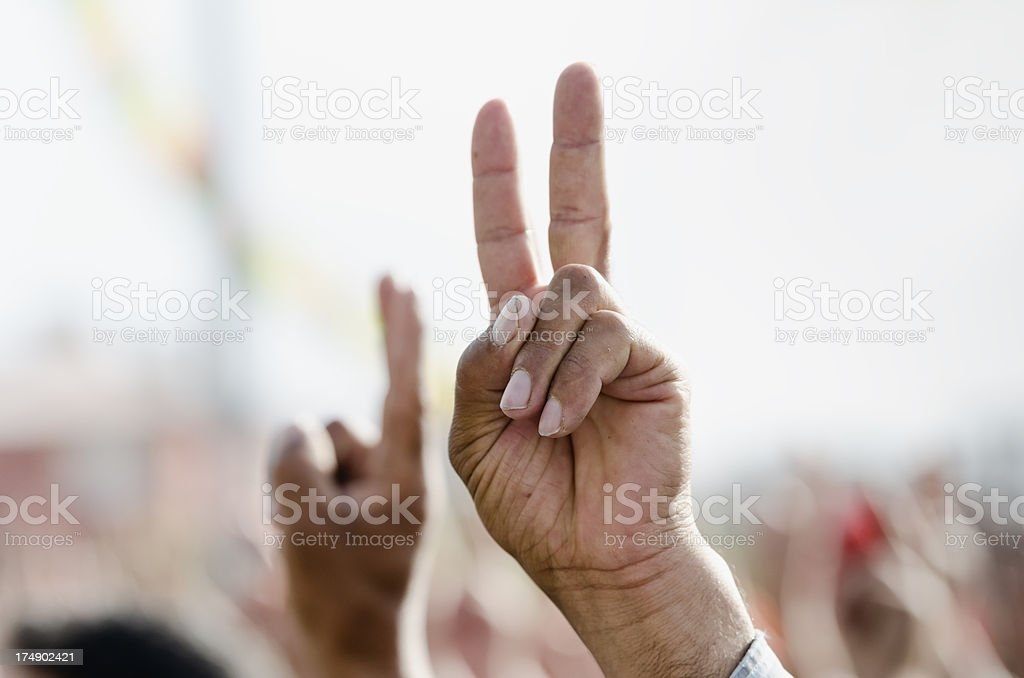 Hand making peace sign during a political rally stock photo