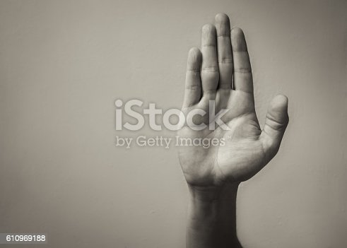 istock Hand making stop sign 610969188