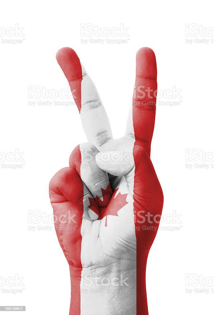 Hand making the V sign, Canada flag painted royalty-free stock photo