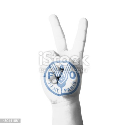 Hand making the V sign, Fist of FAO (Food and Agriculture Organization) flag painted