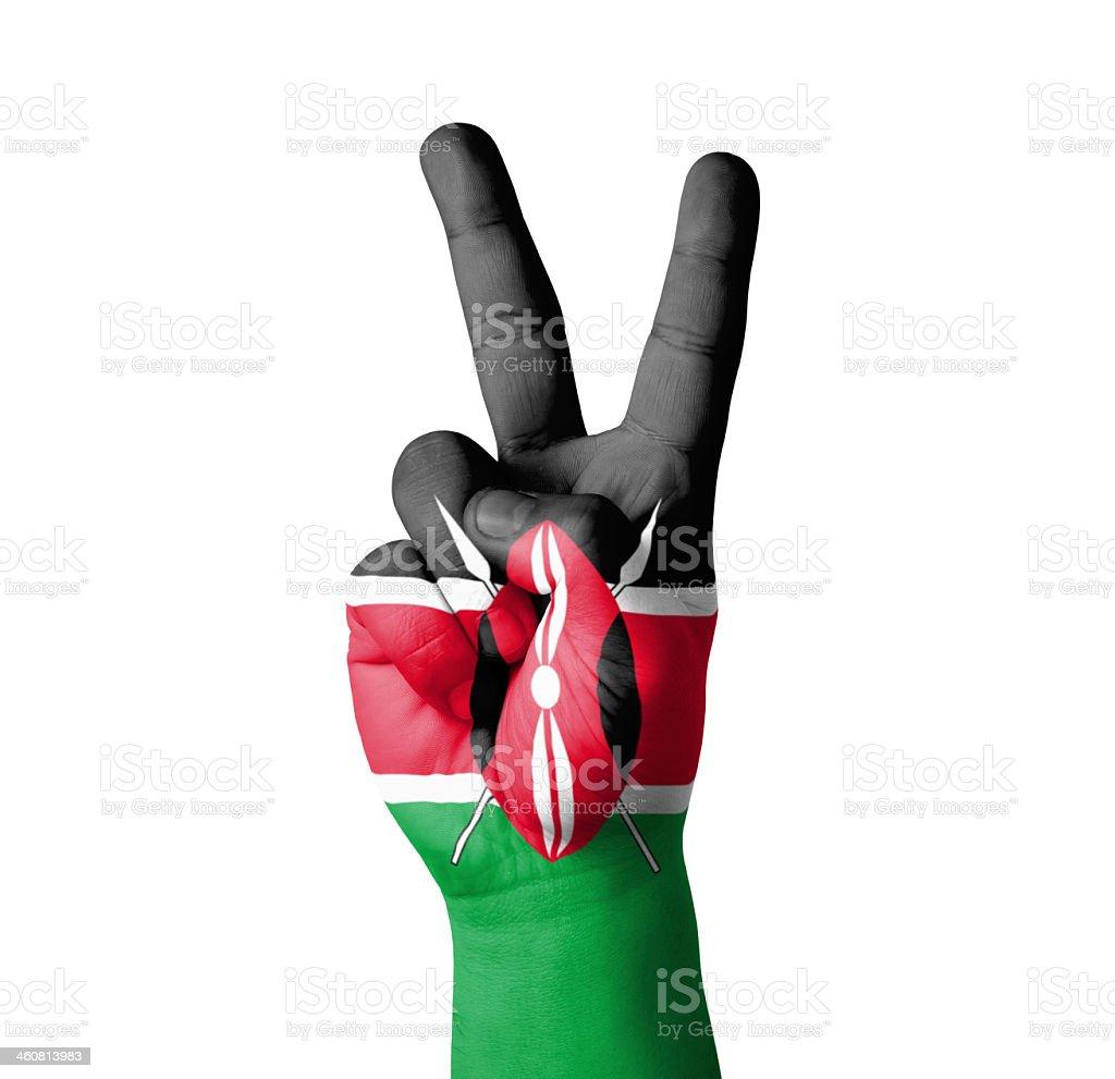 Hand making the V sign, Kenya flag painted stock photo