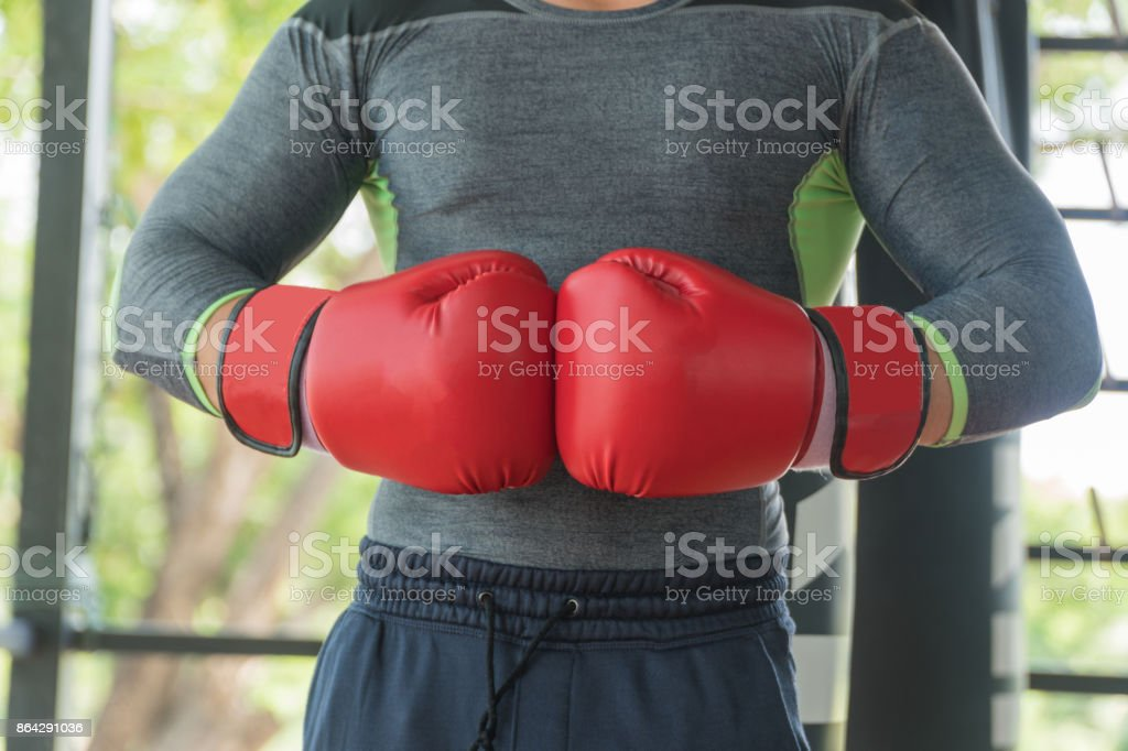Hand male athletes wearing red boxing gloves. royalty-free stock photo