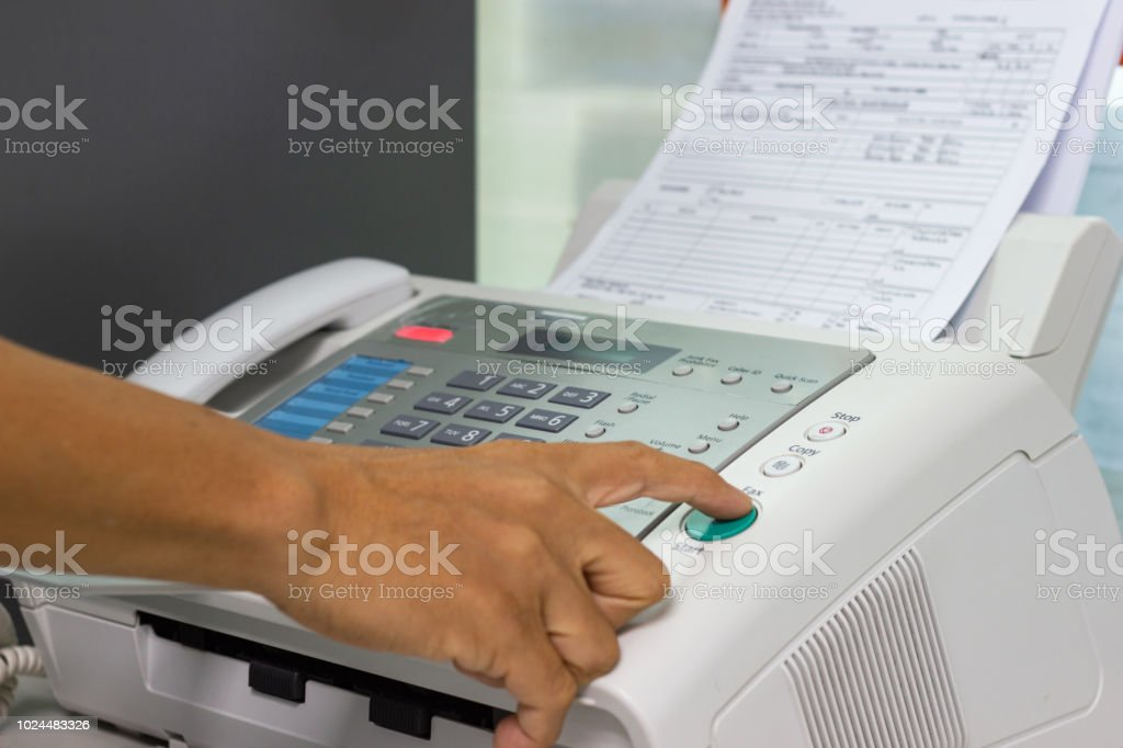 Hand Man Are Using A Fax Machine In The Office Business Concept