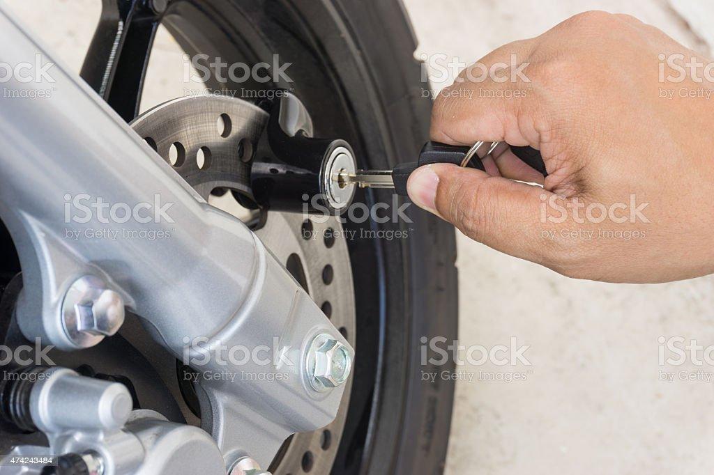 Hand man locking on motorcycle disc brake stock photo