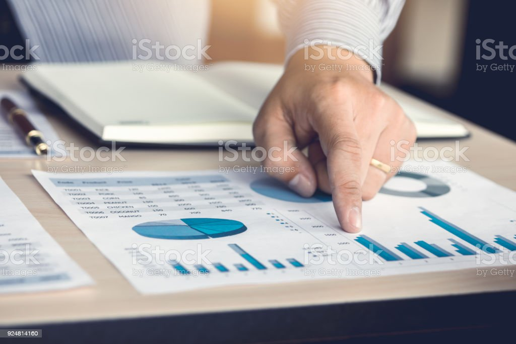 Hand man pointing number on chart report. stock photo
