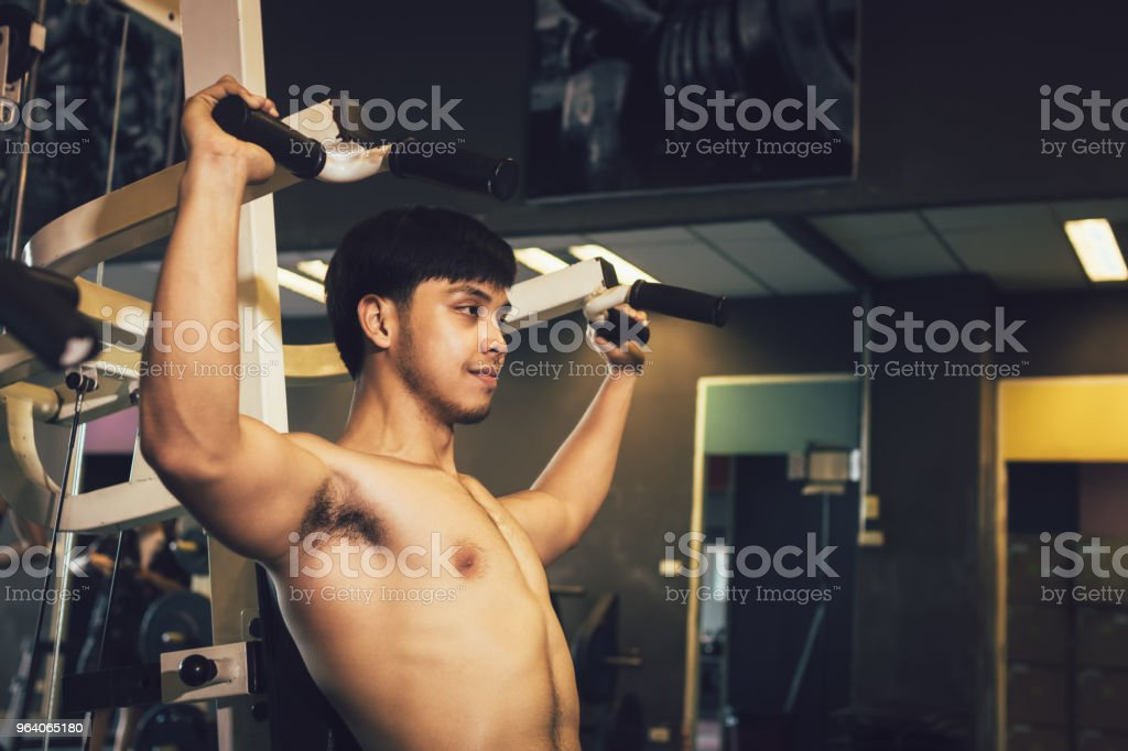 Hand man pulling bar weight at indoor gym. - Royalty-free Adult Stock Photo