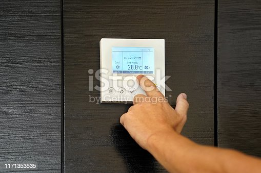 istock hand man turns on air conditioning 1171353535