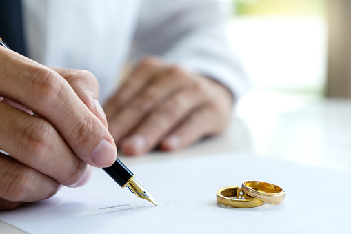 istock Hand man woman on paper with marry ring 1142103635