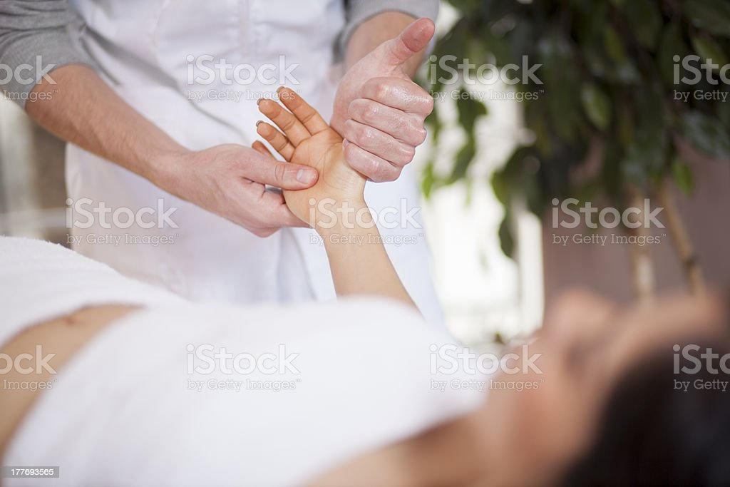 Hand massage at a health and beauty spa stock photo