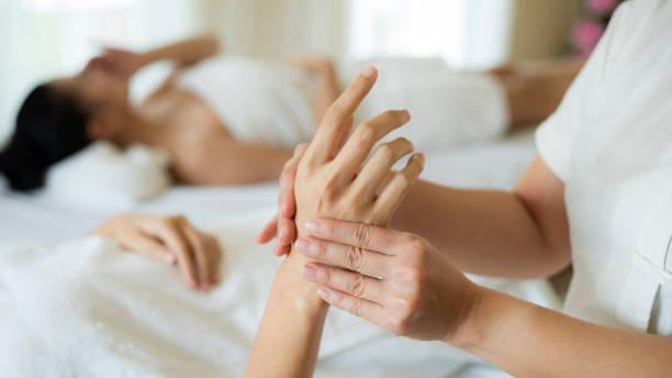 hand massage body care and spa treatments at beauty spa salon stock photo