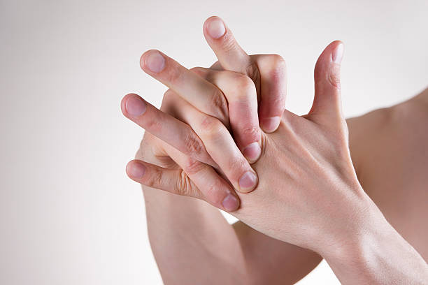 hand massage - knuckle stock photos and pictures