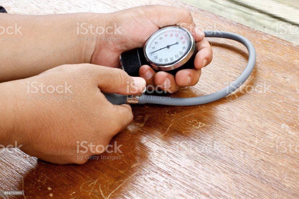 Hand measuring blood pressure stock photo