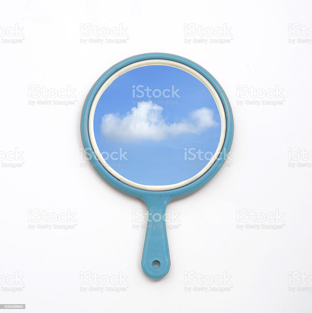 hand mirror with reflection of blue sky, cloud on white stock photo