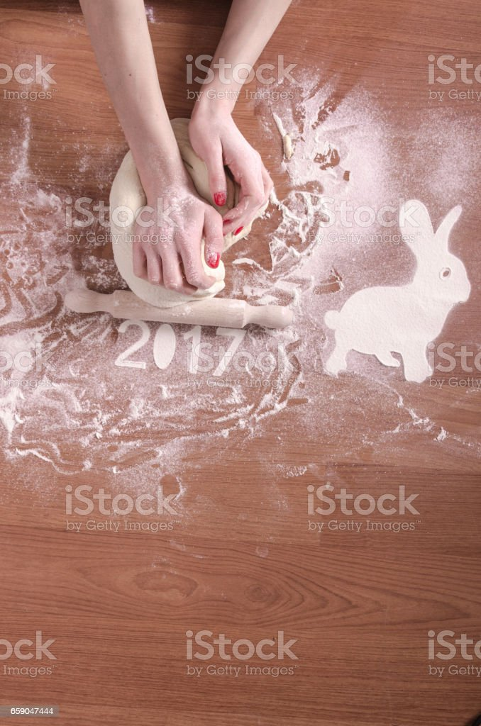 hand mixing, kneading and pressing dough royalty-free stock photo