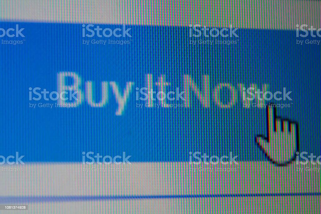 Hand mouse cursor on Buy it now Button stock photo