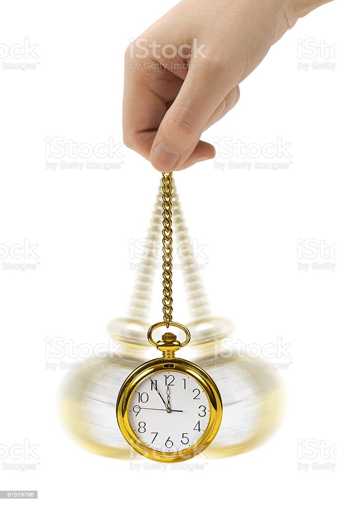 Hand moving retro watch back and forth royalty-free stock photo
