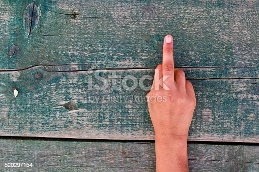 istock hand, numbers and wood 520297154