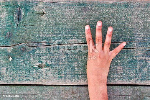 istock hand, numbers and wood 520366950