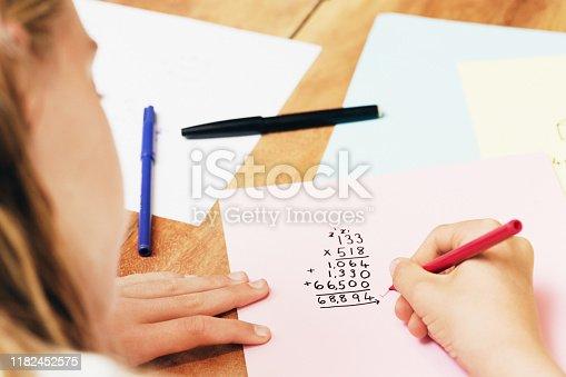 Pre-teen child doing math.