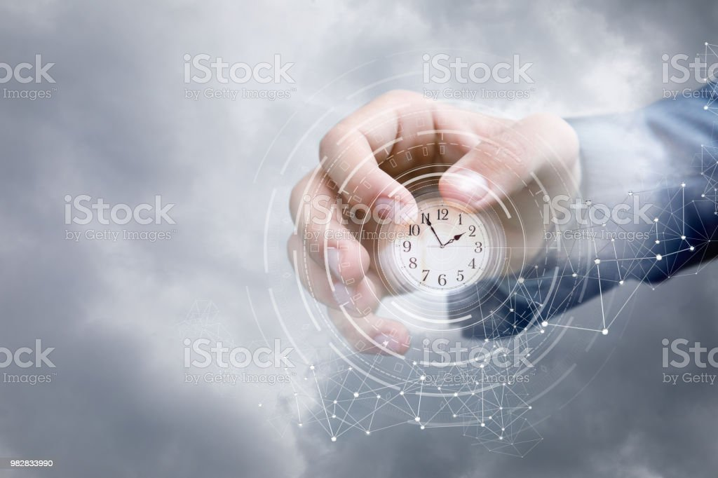 Hand of a businessman in the sky shows the clock . stock photo