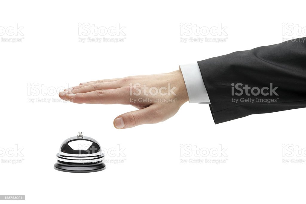 Hand of a businessperson using the hotel bell royalty-free stock photo