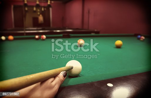 istock Hand of a Caucasian girl playing 692731562