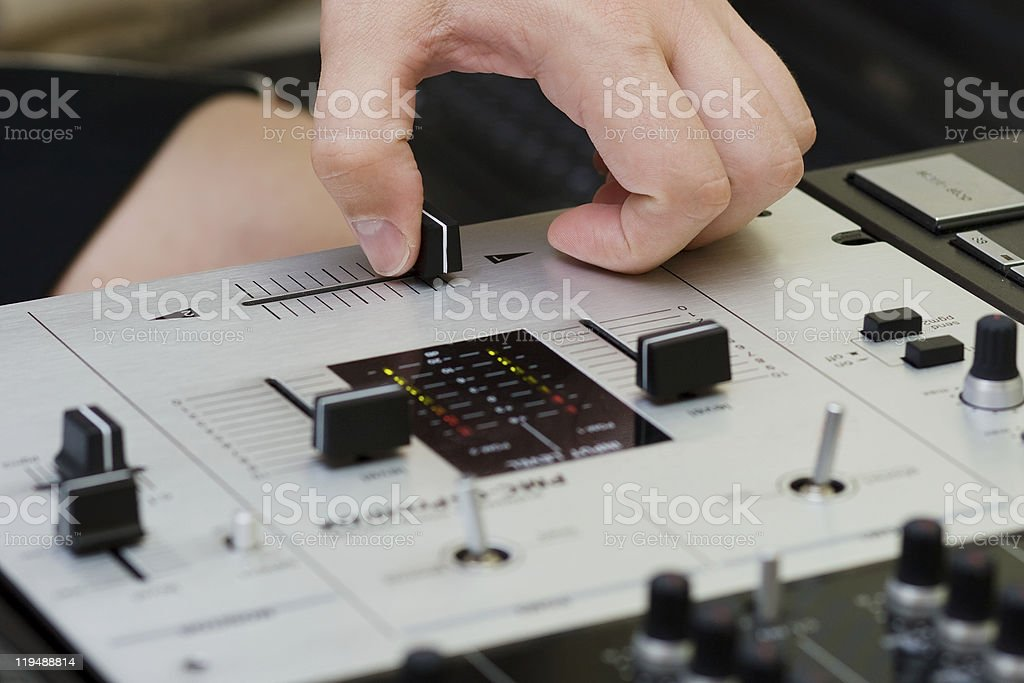 Hand of a dj adjusting the crossfader royalty-free stock photo