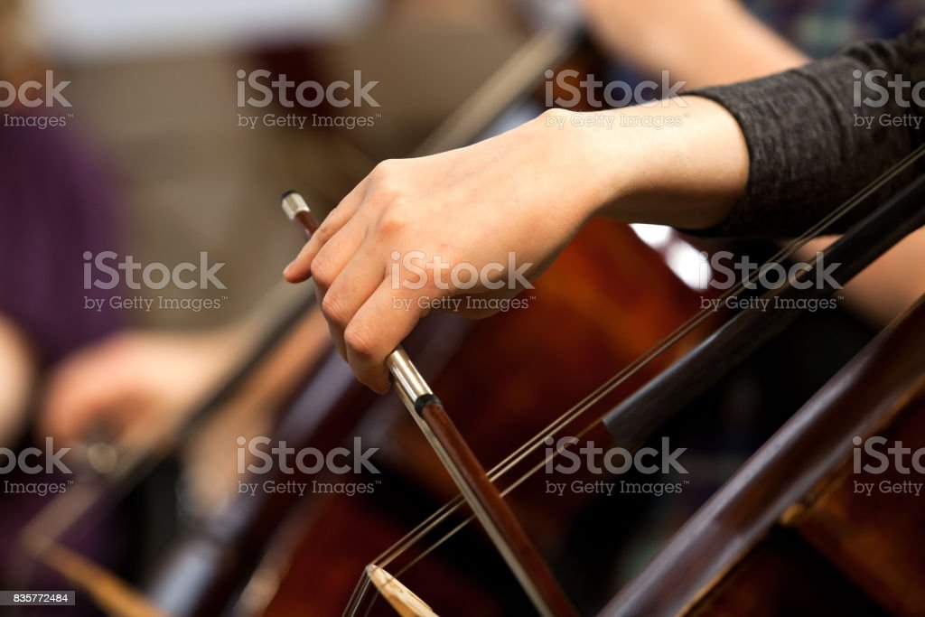 Hand of a girl playing a cello stock photo