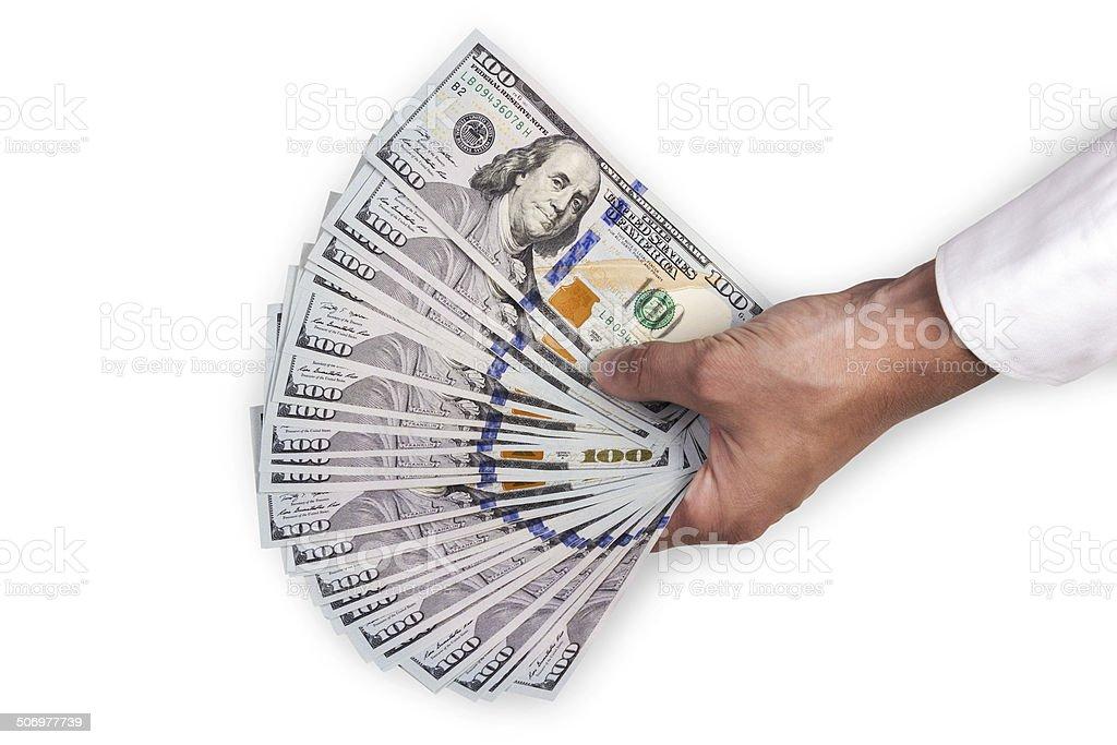 Hand of a man holding dollar bills stock photo